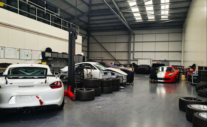 cars being serviced and repaired in Valluga's Silverstone workshop